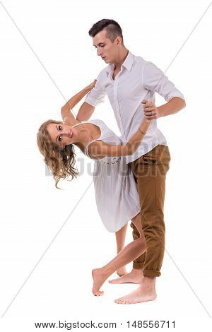 Full length of young couple dancing against isolated white background