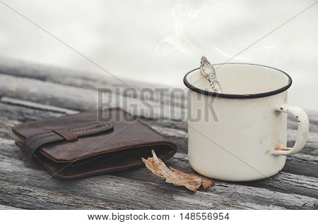 Hot Drink And Old Purse