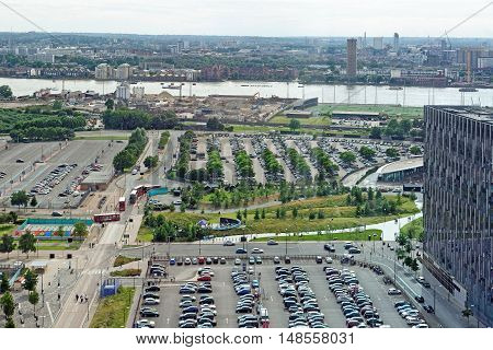 LONDON, ENGLAND - JULY 7, 2016: Aerial view of Greenwich Peninsular river Thames and Isle of Dogs from the Emirates Air Line cable cars.