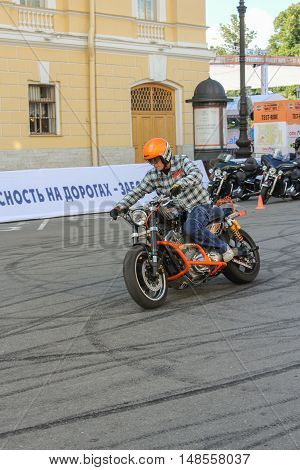 St. Petersburg, Russia - 12 August, Stunt Biker on site,12 August, 2016. The annual International Festival of Motor Harley Davidson in St. Petersburg Ostrovsky Square.