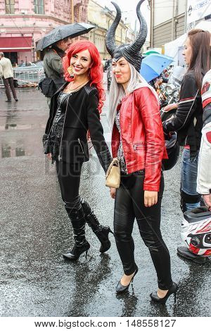 St. Petersburg, Russia - 12 August, Girls in dresses brutal,12 August, 2016. The annual International Festival of Motor Harley Davidson in St. Petersburg Ostrovsky Square.
