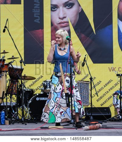 St. Petersburg, Russia - 13 August, The girl at the microphone,13 August, 2016. Africa and the Russian Culture Festival on Krestovsky Island in St. Petersburg.