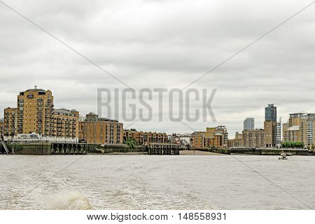Panoramic view over the river Thames near Canary Wharf in London England.