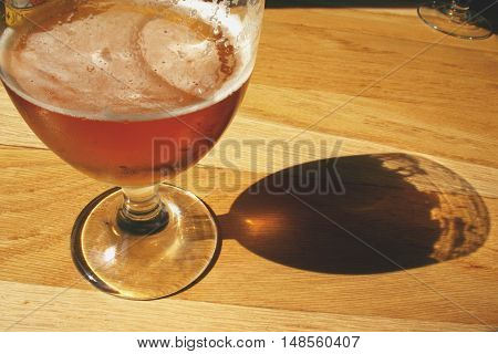Glas of famous belgian beer in a taverne