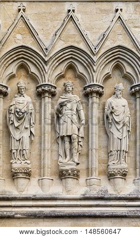 Statues on the exterior of Salisbury Cathedral, Wiltshire, UK. This Anglican Cathedral was built in the 13th Century, and the statues were sculpted by James Redfern and added in the 19th Century.