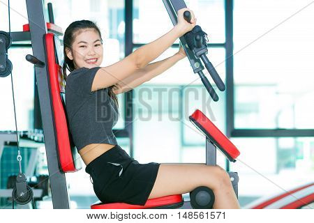 Sexy Young Girl Resting After Shoulder Press Exercise
