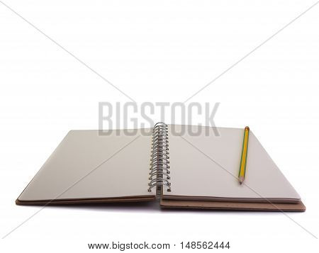notebook and pencil Placed on a white background. (Space for your text)