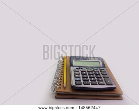 notebook and pencil and calculator Placed on a white background. (Space for your text)