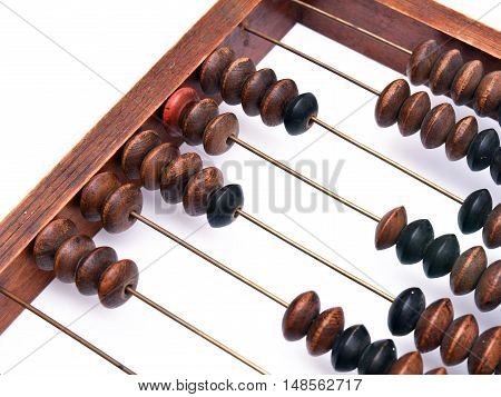 Old wooden abacus on white background. Close up