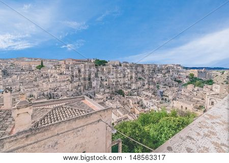 Panoramic View Of Typical Stones (sassi Di Matera) And Church Of Matera Under Blue Sky