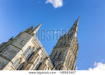 The spire of Salisbury Cathedral against blue sky. Built in the 13th century, with the spire completed in the 14th century, this is the tallest church spire in the UK.