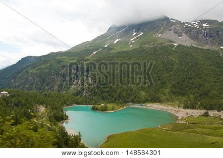 1 Beautiful pond in the mountains along the way of the red train of bernina