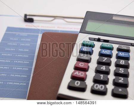 Close up pen and calculator on accountant's desk. accounts concept.