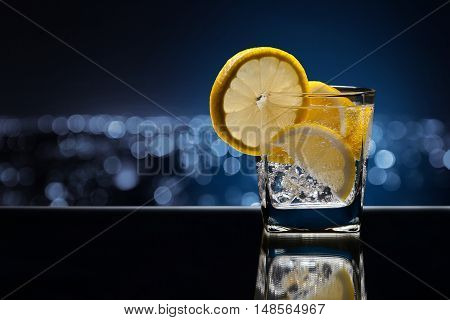 Glass Of Alcoholic Drink With Lemon