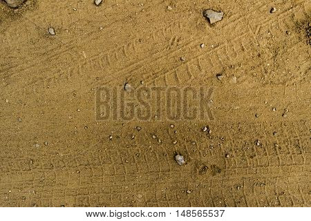 Texture of the soil, soil texture, nature background, ground, wheel tracks, traces on the ground