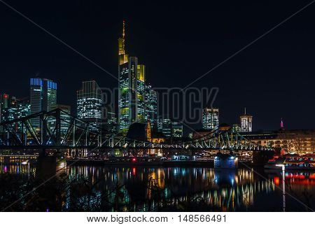 view of Frankfurt downtown from Main river at night Germany
