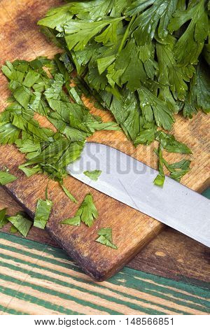 fresh chopped parsley on a chopping board