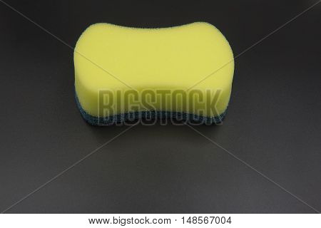 household cleaning sponge for cleaning on black background