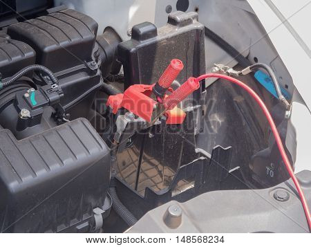 No Car battery, Were removed. red battery Jumper Cables with copper clamps attached to the terminals