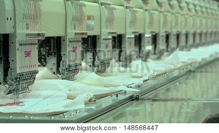 LUBLIN, POLAND - JUN 2016: Automated Embroidery Thread on Fabric Machine Embroidery on Factory.
