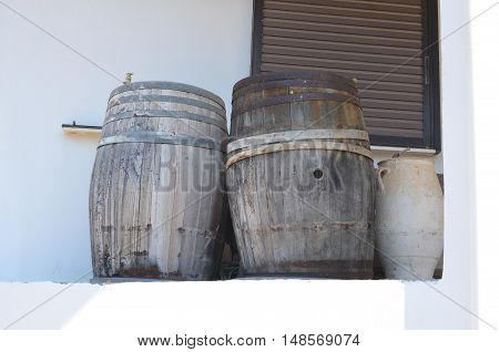 Two old wooden barrels and ceramic jug