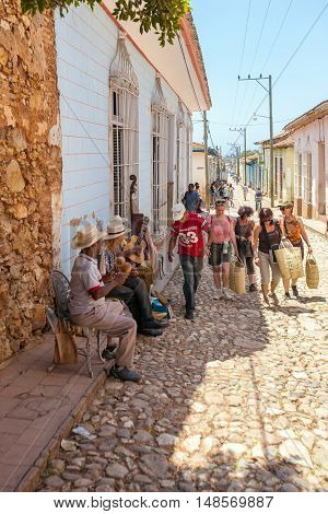 Trinidad, Cuba - March 30, 2012: Street Musicians Perform Songs For Tourists