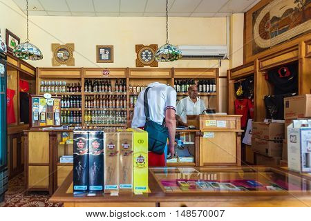 Trinidad, Cuba - March 30, 2012: Tourists Buy Rum And Cigars In The Gift Shop