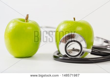 Healthy Lifestyle Concept Medical stethoscope and apple for diet