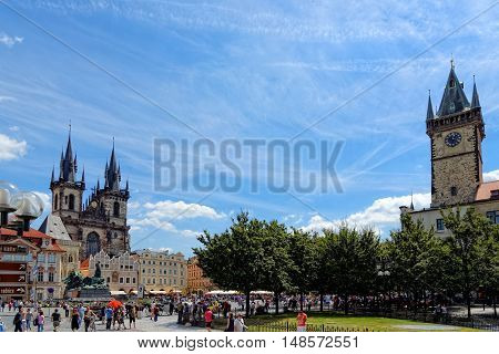 PRAGUE, CZECH REPUBLIC - JULY 3, 2014: The Old town square cityscape with the Tyn Cathedral and the old City Hall. Prague is Europe's 5th most visited city and World Heritage Site by UNESCO.