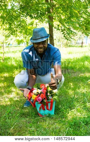 Portrait of African American Cheerful black man smiling on nature