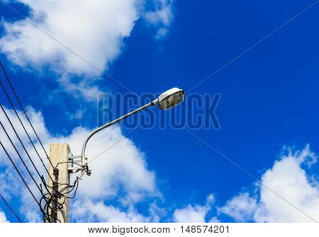 Street lamps on sky  background with white clouds.