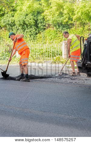 Udine Italy - June 28 2016 : Workers on a road construction industry and teamwork