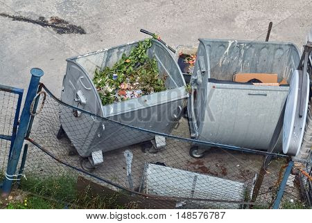 Opened metal dumpsters on the street viewed from above