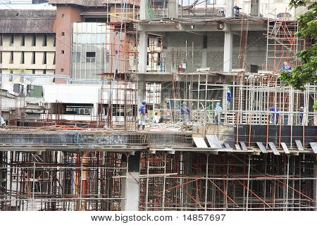 Urban construction site with workmen in downtown manila