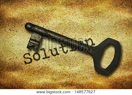 Old key and word Solution written on grunge background