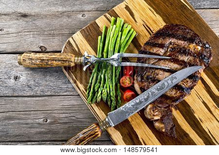 Fresh grilled rib eye steak ready to eat with room for your type.