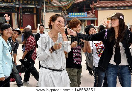 Mianyang China - October 15 2010: A group of Chinese university students on a visit to the Sheng Shui Buddhist temple