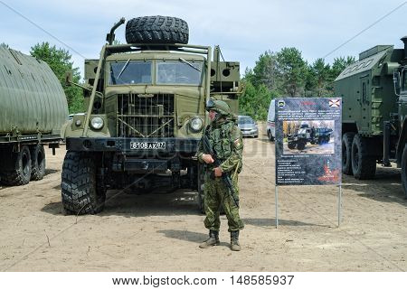 Tyumen, Russia - June 11, 2016: Cadet of Tyumen highest military and engineering command school in Polite people uniform near TMM-3 mechanized bridge vehicle