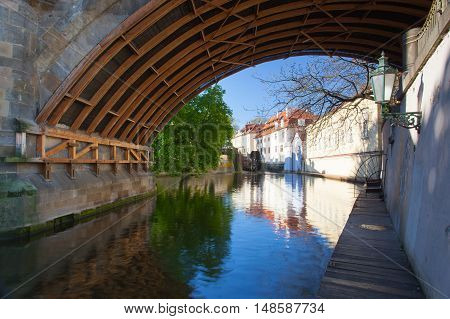 Kampa Island also known as Venice of Prague in the Mala Strana the old houses are reflected in the narrow river Devil (Czertovka). The old watermill .Czech Republic Prague .