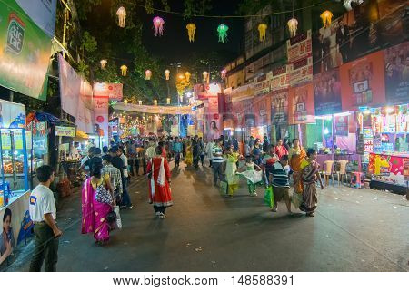 KOLKATA INDIA - OCTOBER 18 2015 : Night image of decorated street of Kolkata shot at colored light during Durga Puja festival West Bengal India. Durga Puja is biggest religious festival of Hinduism.