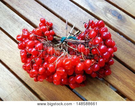 Bush red viburnum, associated with a thread, on wooden boards