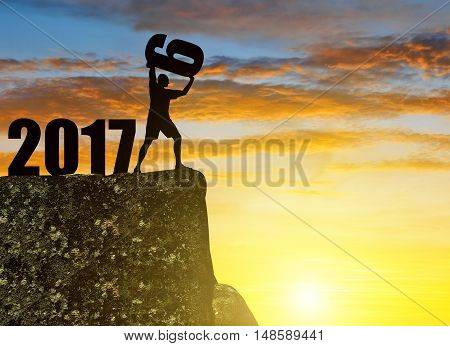 Silhouette of man throws a six. Concept New Year 2017
