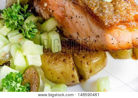 Salmon skewers with fried potatoes the seafood