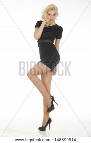 beautiful young attractive blonde women wear black dress in studio
