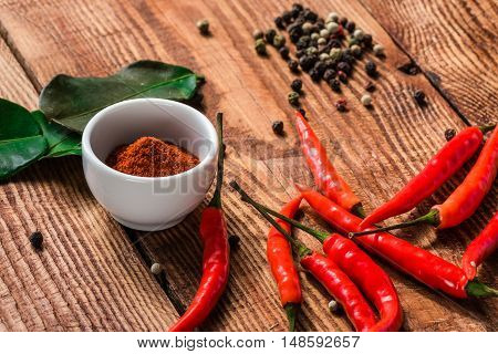 Different spices scattered on wooden table. Condiment for cooking.