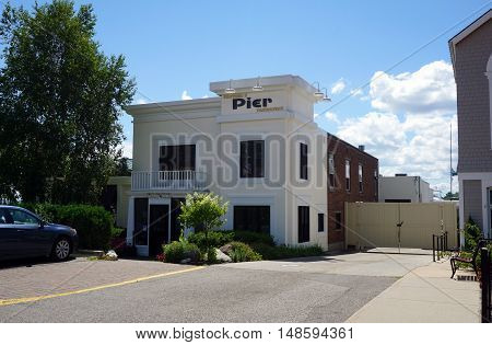 HARBOR SPRINGS, MICHIGAN / UNITED STATES - AUGUST 1, 2016: One may enjoy fine dining at Stafford's Pier Restaurant, adjacent to the Harbor Springs Municipal Marina.