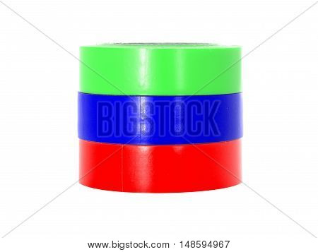 Green, blue, red insulating tape reels, isolated on white background