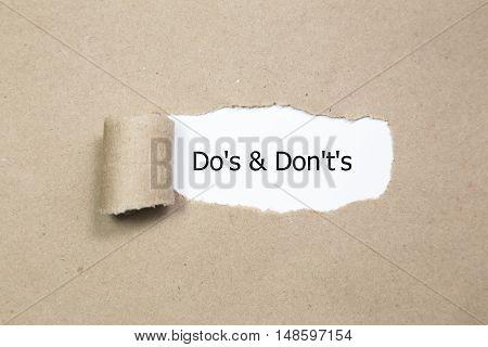 do it now written under torn paper