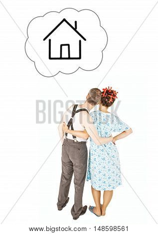 Funny Family Couple Embracing And Looking On Dream House