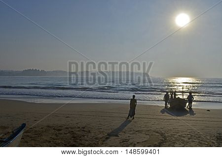 Fishing boat on the shore with the fishermen